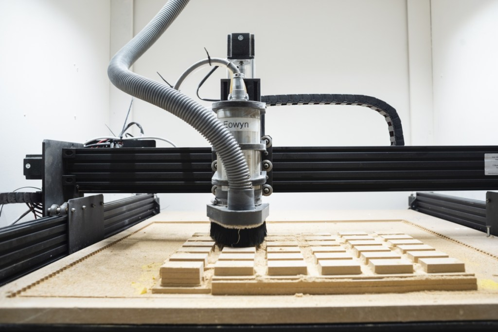 The Workbee CNC router from Oozenest making a fixture. Emergo Designs uses this machine for making the packaging.